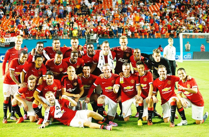 Manchester United pose for a photograph following their victory over Liverpool