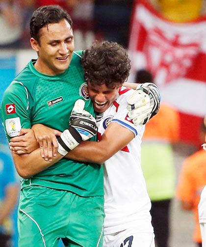 Costa Rica midfielder Yeltsin Tejeda (17) hugs goalkeeper Keylor Navas