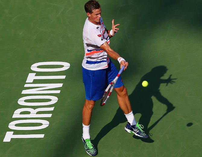 Vasek Pospisil of Canada returns a shot to Richard Gasquet of France during Rogers Cup at Rexall Centre at York University on Tuesday