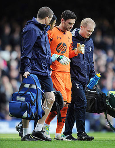 Hugo Lloris of Tottenham Hotspur leaves the field through injury after colliding with Everton's Romelu Lukaku during their Barclays Premier League match at Goodison Park in Liverpool last season
