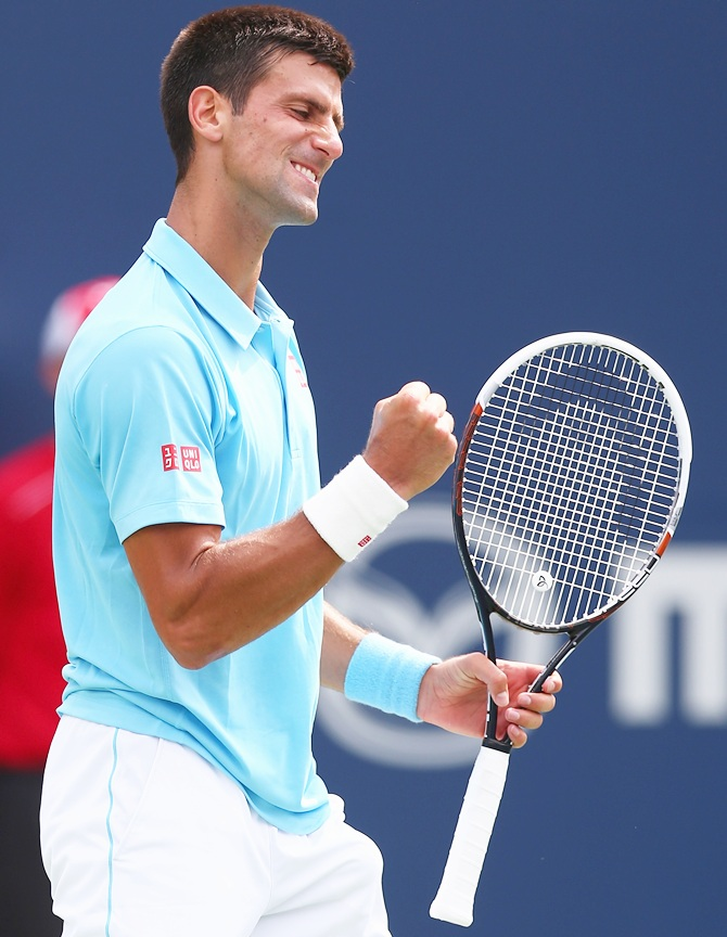 Novak Djokovic of Serbia celebrates a game against Gael Monfils of France during Rogers Cup at Rexall Centre at York University