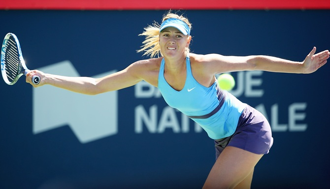 Maria Sharapova of Russia returns a shot