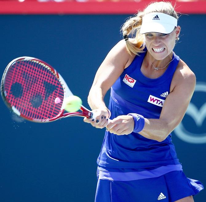 Angelique Kerber of Germany returns a shot to Caroline Garcia of France