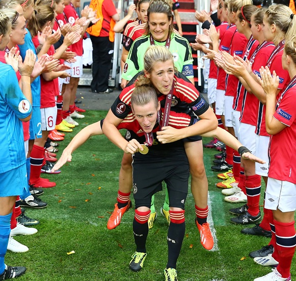 Simone Laudehr and Luisa Wensing of Germany celebrate after the UEFA Women's EURO 2013 final