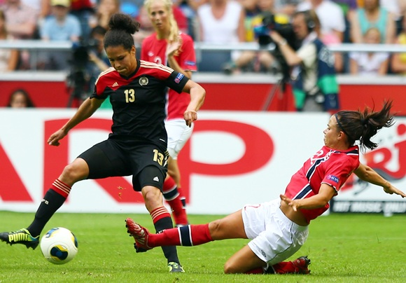Celia Okoyino Da Mbabi (left) of Germany and Cathrine Dekkerhus (right) of Norway battle for the ball