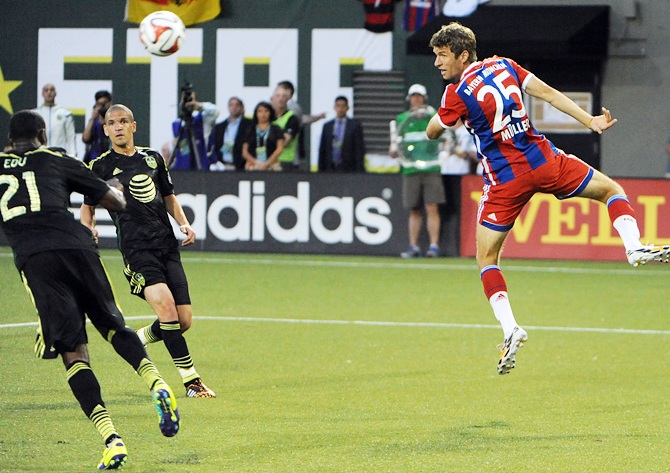 Thomas Muller, right, of Bayern Munich heads the ball into the box during the second half of the game against the MLS All-Stars st Providence Park