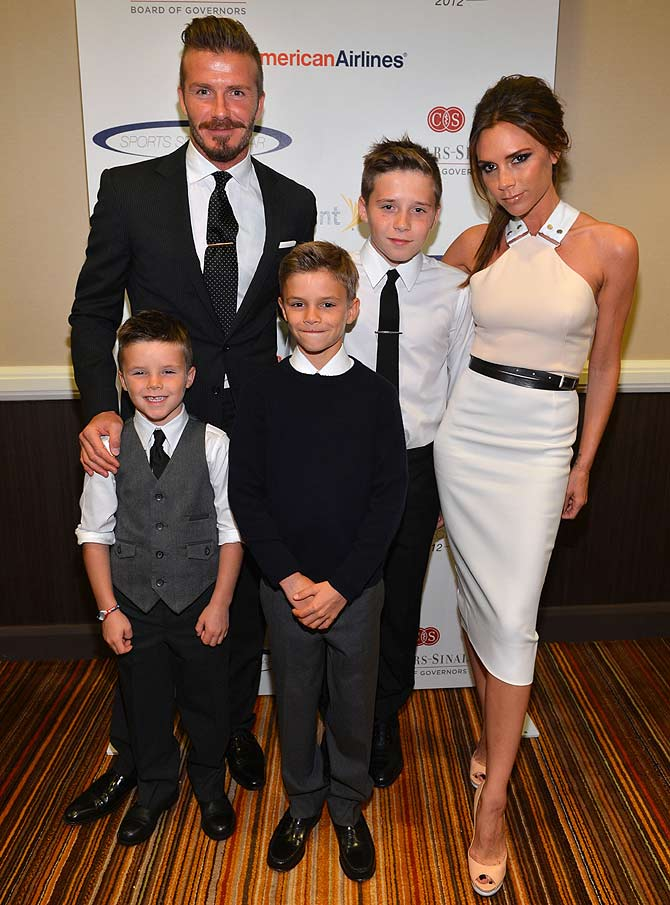 Soccer player David Beckham, wife Victoria Beckham and sons (from left) Cruz, Romeo and Brooklyn Beckham