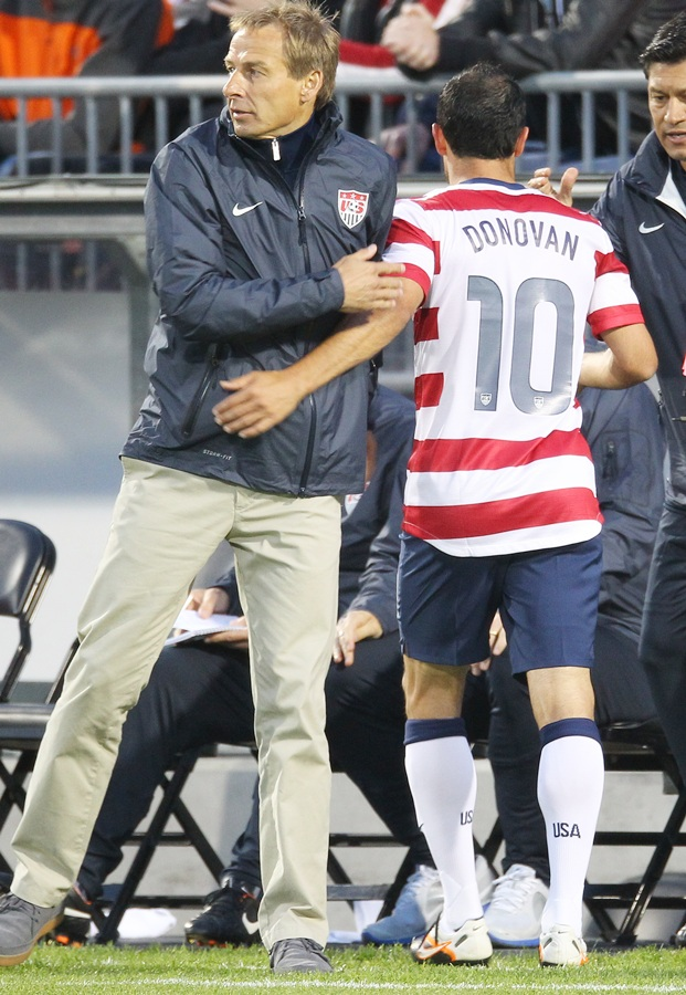 Head coach Jurgen Klinsmann of USA congratulates Landon Donovan