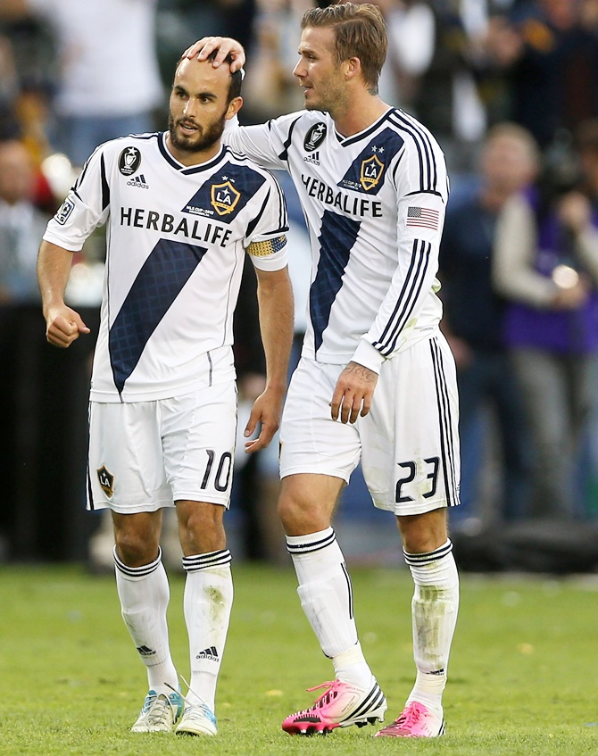 Landon Donovan and David Beckham of Los Angeles Galaxy react