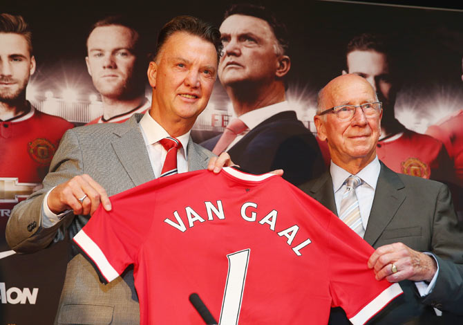 Louis van Gaal at a press conference with Sir Bobby Charlton as he is unveiled as the new Manchester United manager at Old Trafford in Manchester on July 17