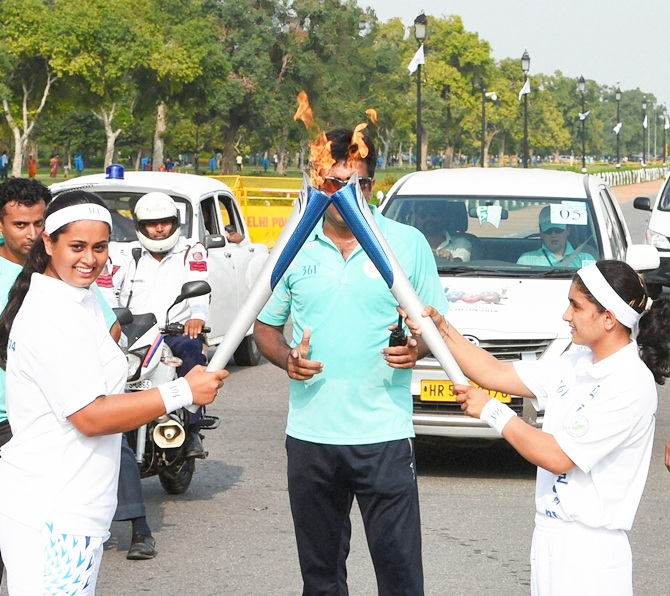Shreyasi Singh, left, during the torch relay ceremony of 17th Asian Games 2014 at Rajpath in New Delhi on Saturday