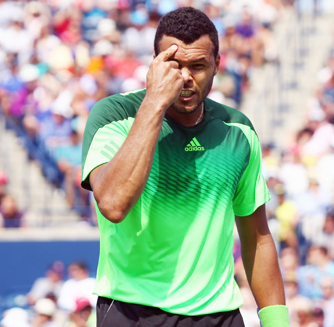 Jo-Wilfried Tsonga of France reacts after a point against Andy Murray of Great Britain in the quarter-finals on Friday