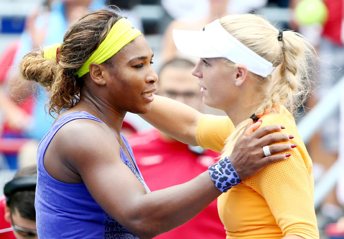 Serena Williams of the USA hugs Caroline Wozniacki of Denmark after their quarter-final match on Friday