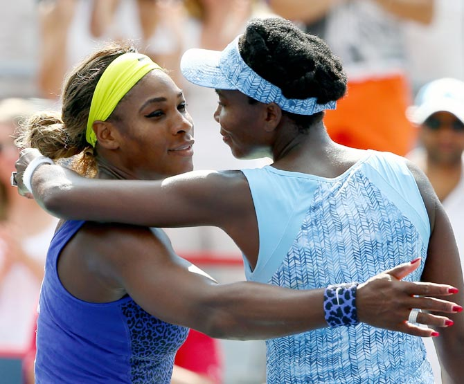 Serena Williams (left) hugs her sister Venus after the match