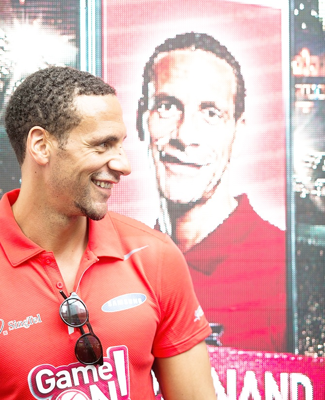 Rio Ferdinand greets supporters during a meet-the-fans session