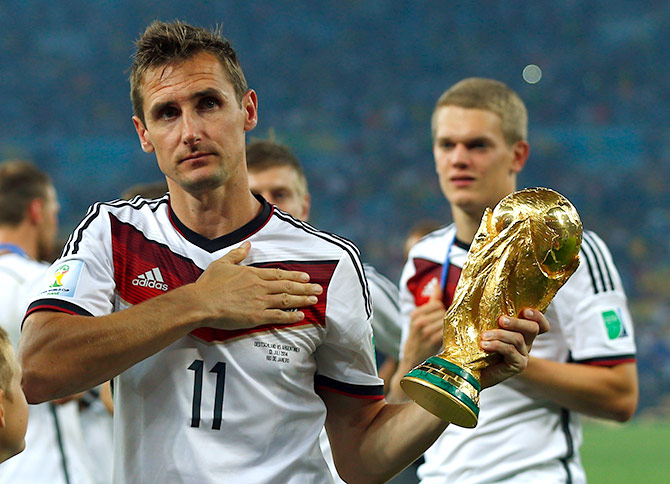 Germany's Miroslav Klose holds the World Cup trophy after the 2014 World Cup final against Argentina at the Maracana stadium in Rio de Janeiro