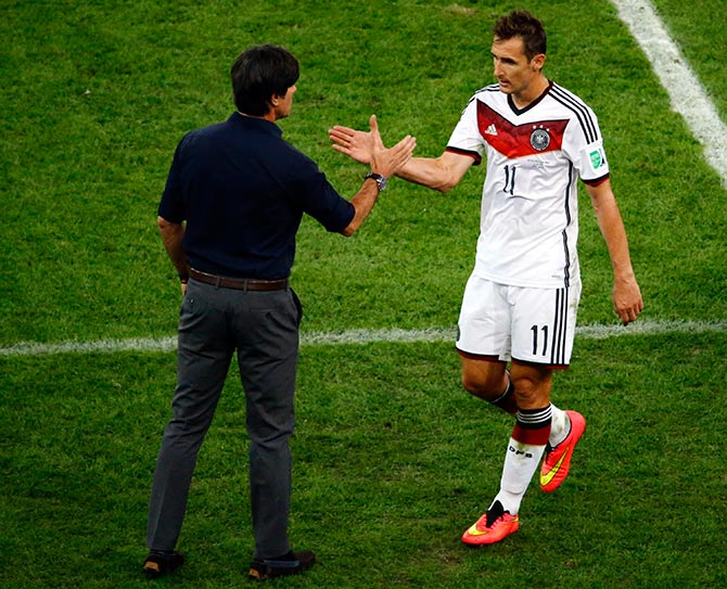 Germany's Miroslav Klose (R) shakes hands with coach Joachim Loew