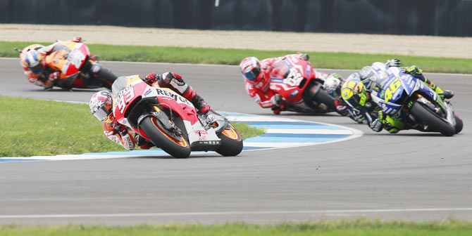 Honda MotoGP rider Marc Marquez (93) of Spain leads other riders through a turn during the Indianapolis GP on Sunday