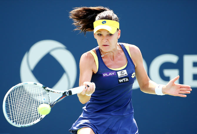 Agnieszka Radwanska of Poland returns a shot to Venus Williams of the USA on Sunday