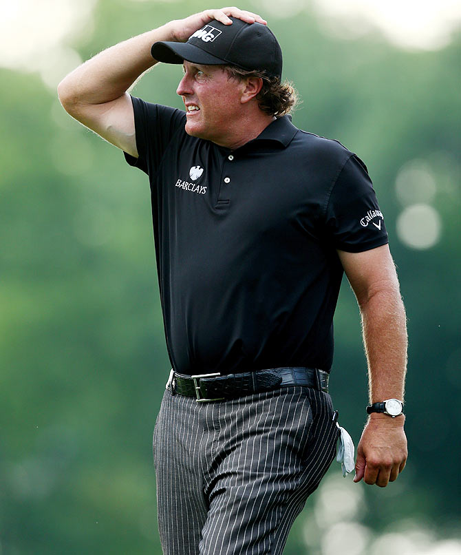 Phil Mickelson of the United States reacts on the tenth green during the final round of the 96th PGA Championship at Valhalla Golf Club on Sunday