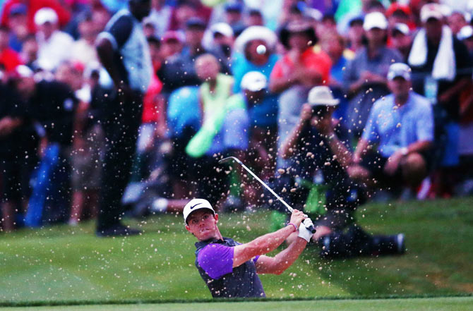 Rory McIlroy of Northern Ireland hits a shot from a greenside bunker on the 18th hole during the final round of the 96th PGA Championship at Valhalla Golf Club on Sunday