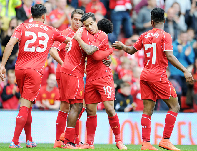 Daniel Sturridge (centre) of Liverpool celebrates with team-mate Philippe Coutinho after scoring