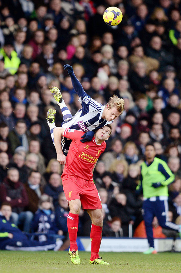 Matej Vydra of West Bromwich climbs above Steven Gerrard of Liverpool to win a header during their Premier League match at The Hawthorns in West Bromwich