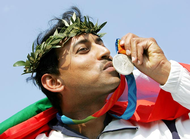 Rajyavardhan Singh Rathore celebrates after winning the silver medal at the 2004 Olympic Games in Athens, on August 17, 2004