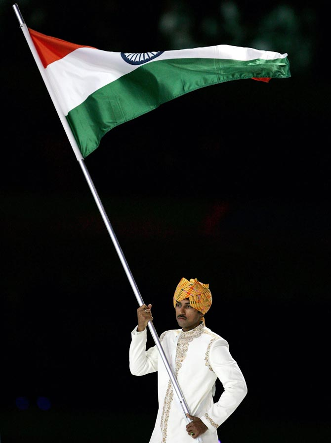 Rajyavardhan Singh Rathore carries the Indian flag during the opening ceremony of the 2006 Commonwealth Games in Melbourne