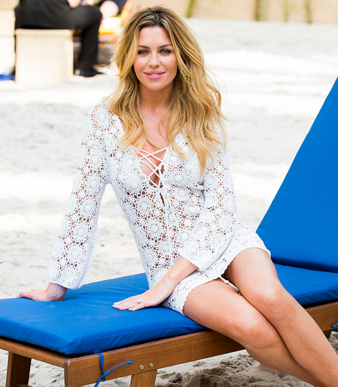 Abbey Clancy attends a photocall to launch the Scholl Pop Up Pedicure Beach at Westfield
