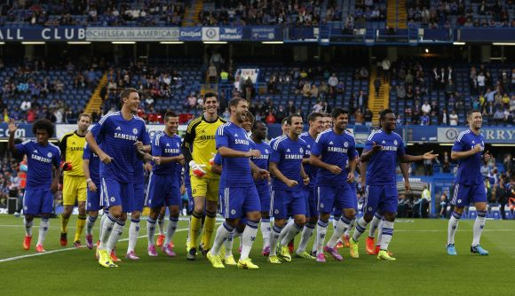 Chelsea players celebrate after winning a game