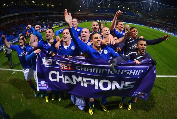Leicester City players celebrate winning the Championship