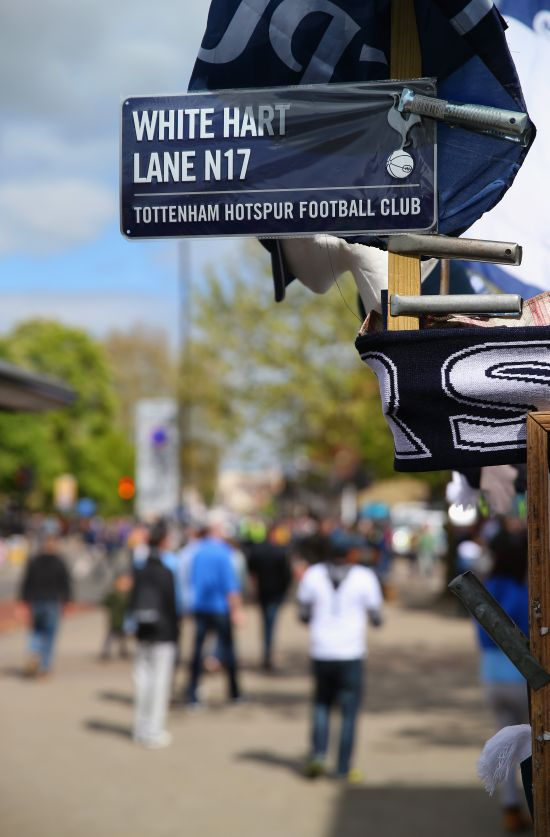 A sign for White Hart Lane is seen on street stall ahead of the Barclays Premier League match
