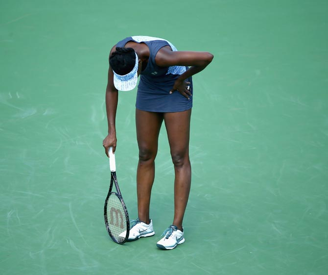 Venus Williams is dejected after losing a point during her match