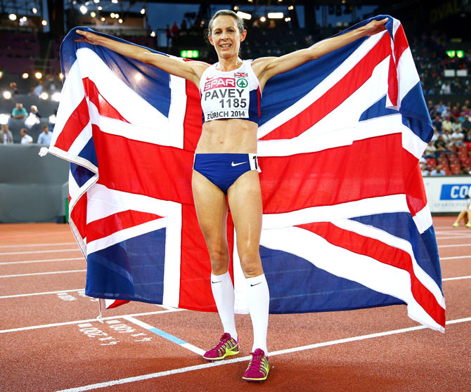 Jo Pavey of Great Britain and Northern Ireland poses with a Union Jack after winning gold in the Women's 10,000 metres final during day one of the 22nd European Athletics Championships at Stadium Letzigrund on Tuesday
