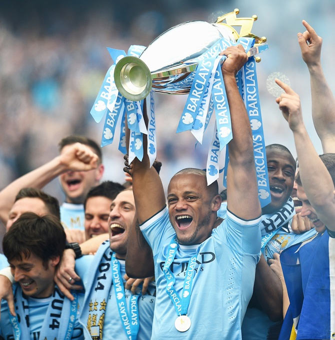 Vincent Kompany of Manchester City lifts the Premier League trophy in May