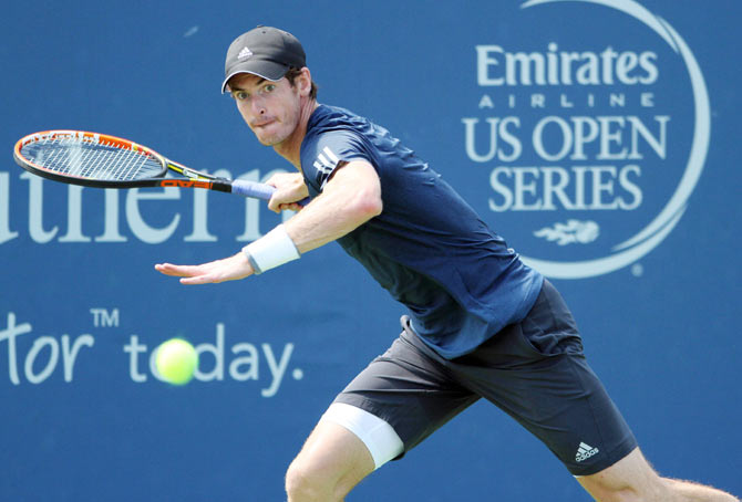 Andy Murray returns a shot from Joao Sousa on day three of the Western and Southern Open tennis tournament at Linder Family Tennis Center on Wednesday