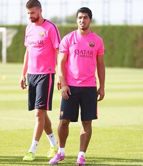 Luis Suarez with Gerard Pique