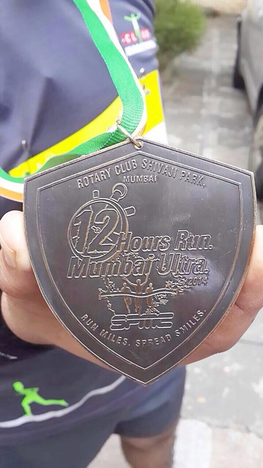 A participant shows off his medal