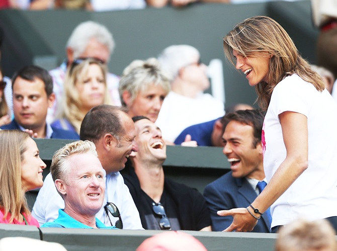Andy Murray of Great Britain's girlfriend Kim Sears shakes a joke with his coach Amelie Mauresmo