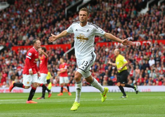 Gylfi Sigurdsson of Swansea City celebrates scoring his team's second goal during the Barclays Premier League match between Manchester Unite