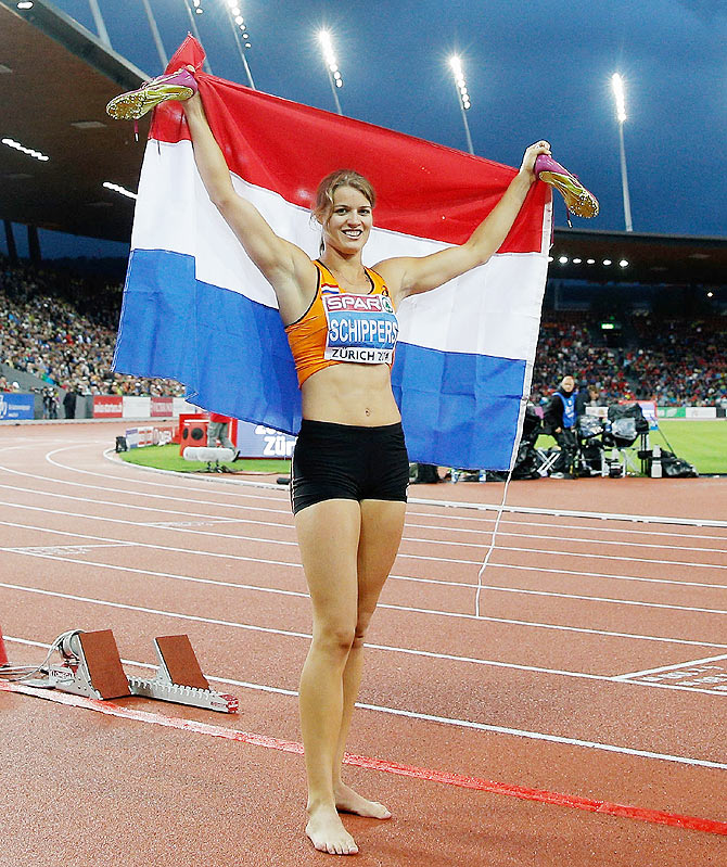 Dafne Schippers of the Netherlands celebrates with the Dutch national flag after winning gold in the Women's 200 metres final during day four of the 22nd European Athletics Championships at Stadium Letzigrund in Zurich on Friday