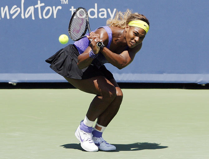Serena Williams returns the shot of Jelena Jankovic on Friday
