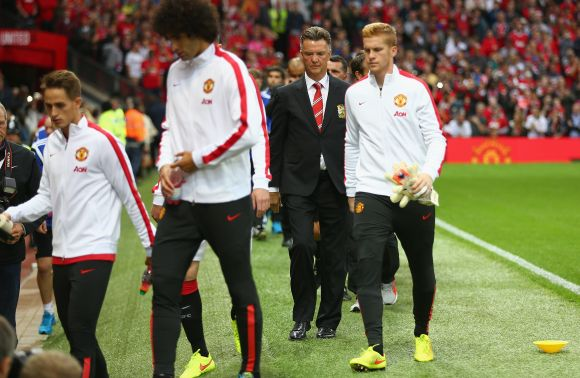 Louis Van Gaal walks out during half-time