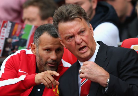 Manchester United Manager Louis van Gaal speaks with Assistant Ryan Giggs (L) prior to the Barclays Premier League match between Manchester United and Swansea City