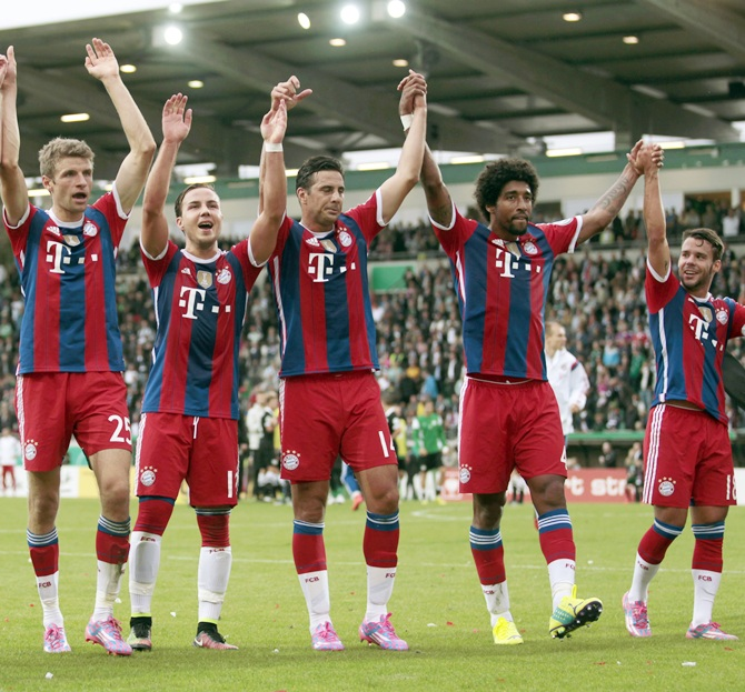 Bayern Munich's players celebrate their victory over   Preussen Muenster after their German soccer cup (DFB Pokal) first round soccer match