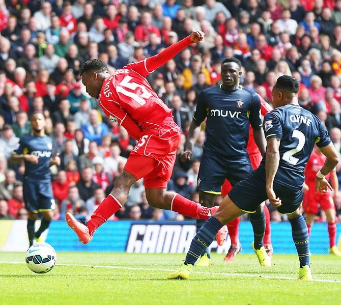Daniel Sturridge of Liverpool scores