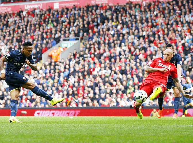 Southampton's Nathaniel Clyne (left) scores a goal against Liverpool