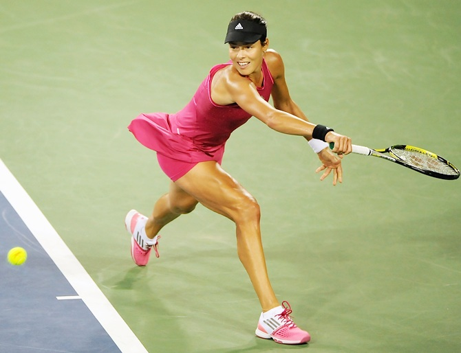 Ana Ivanovic of Serbia returns to Maria Sharapova of Russia