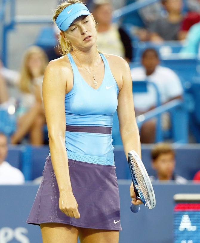 Maria Sharapova of Russia is dejected in her match against Ana Ivanovic of Serbia